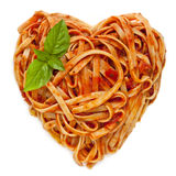 Spaghetti Heart Shape with Basil Stock Images