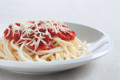 Spaghetti with homemade tomato sauce and cheese Stock Photo