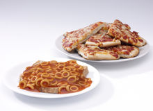 Spaghetti hoops and pizza Stock Images