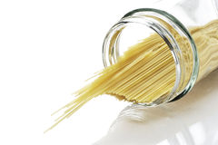 Spaghetti included in a bottle. Spaghetti by which picture photography was carried out in background white Royalty Free Stock Photos