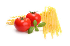 Spaghetti ingredient. Macaroni, tomatoes and basil - spaghetti ingredient isolated on white stock photos