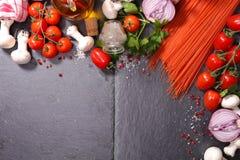 Spaghetti and ingredient Stock Photos