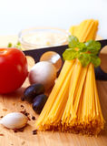 Spaghetti and ingredients Stock Photography