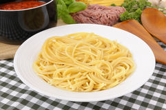 Bowl of Italian spaghetti with cooking ingredients Stock Photography