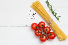Spaghetti ingredients concept on white background, top view royalty free stock images