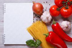 Spaghetti and ingredients for preparing pasta on the table Royalty Free Stock Image
