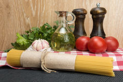 Spaghetti and ingredients for seasoning Stock Photography