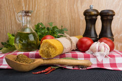 Spaghetti and ingredients for seasoning Royalty Free Stock Image