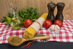 Spaghetti and ingredients for seasoning Stock Photo