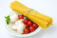 Spaghetti with ingridients in plate Royalty Free Stock Image