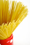 Spaghetti inside a red jar closeup Stock Image