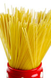 Spaghetti inside a red jar closeup Royalty Free Stock Photos