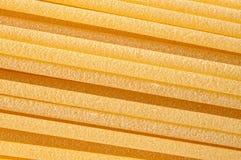 Spaghetti, Italiaanse deegwarenachtergrond stock foto