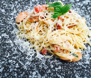 Spaghetti Italian and German sausage with cheese. Spaghetti Italian and German sausage with cheese on marble plate, fusion and modern food Royalty Free Stock Images