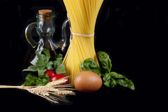 Spaghetti with Italian ingredients Stock Images