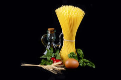 Spaghetti with Italian ingredients Stock Photos