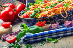 Spaghetti. Italian and Mediterranean cuisine. Spaghetti bolognese with cherry tomato and basil. Stock Images