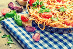Spaghetti. Italian and Mediterranean cuisine. Spaghetti bolognese with cherry tomato and basil. Royalty Free Stock Photos