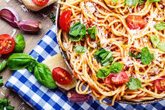 Spaghetti. Italian and Mediterranean cuisine. Spaghetti bolognese with cherry tomato and basil. Stock Photo