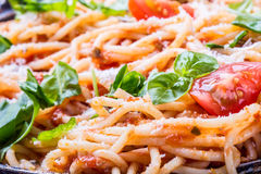 Spaghetti. Italian and Mediterranean cuisine. Spaghetti bolognese with cherry tomato and basil. Royalty Free Stock Photo