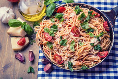 Spaghetti. Italian and Mediterranean cuisine. Spaghetti bolognese with cherry tomato and basil. Royalty Free Stock Images