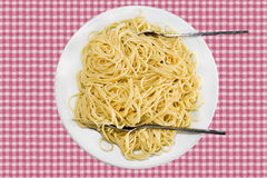 Spaghetti. Italian pasta on a checkered tablecloth Royalty Free Stock Images