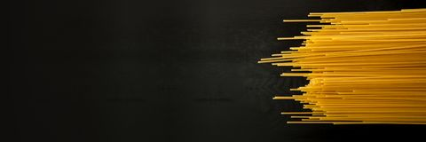 Free Spaghetti Italian Pasta On A Wood Black Textured Background. Close-up View From The Top. Free Space For Text. Banner Stock Photography - 139306172