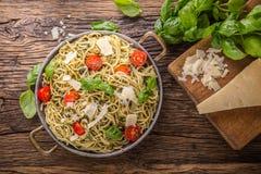 Spaghetti. Italian pasta spaghetti with basil pesto cherry tomatoes and olive oil Stock Photo
