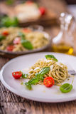 Spaghetti. Italian pasta spaghetti with basil pesto cherry tomatoes and olive oil Royalty Free Stock Images