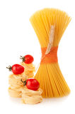 Spaghetti, Italian pasta and tomatoes on white background Stock Photography
