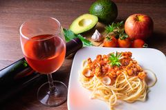 Spaghetti and Italian pasta with wine royalty free stock image