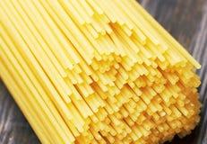 Spaghetti italian pasta on wood Stock Images