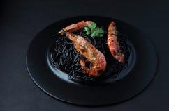 Spaghetti with king prawns Stock Photos
