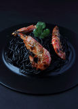 Spaghetti with king prawns Stock Images