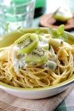 Spaghetti with kiwi Stock Photo