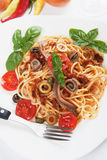 Spaghetti a la puttanesca. With caper, anchovy and olives stock image