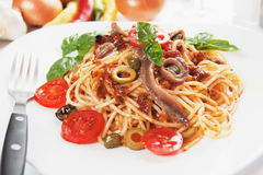 Spaghetti a la puttanesca. With caper, anchovy and olives royalty free stock photo