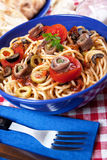 Spaghetti a la puttanesca. With caper, anchovy and olives royalty free stock photos