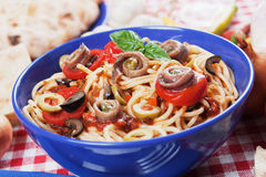 Spaghetti a la puttanesca. With caper, anchovy and olives royalty free stock photography