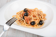 Spaghetti a la puttanesca with caper and olives Royalty Free Stock Photography