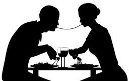Spaghetti lovers. Editable  silhouette of lovers eating spaghetti together with all elements as separate objects Stock Photos