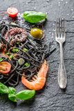 Spaghetti made from black pasta and shrimp Stock Photo
