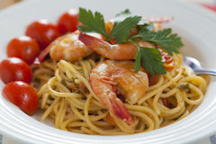 Spaghetti marinara. Authentic Italian spaghetti marinara with fresh prawns, cherry tomatoes and fork Stock Photo