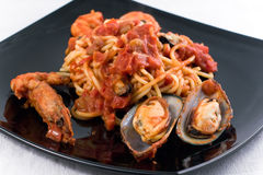 Spaghetti Marinara. With mussel om a black plate Stock Images