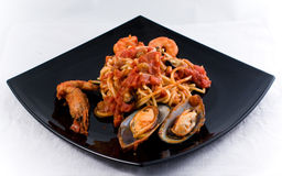 Spaghetti Marinara. With mussel om a black plate Royalty Free Stock Photography