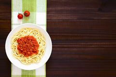Spaghetti with Marinara Tomato Sauce. Traditional Italian Spaghetti alla Marinara spaghetti with tomato sauce in bowl, photographed overhead on dark wood with royalty free stock photo