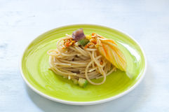 Spaghetti with marinated anchovy, zucchini and zucchini flowers. Italy stock photos
