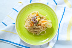 Spaghetti with marinated anchovy, zucchini and zucchini flowers. Italy royalty free stock photography