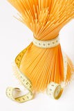 Spaghetti with measuring tape royalty free stock images