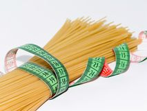 Spaghetti with measuring tape Royalty Free Stock Photography